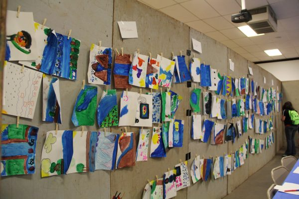Aquatic Artwork lines the walls of the festival in Dumas. This activity challenges the students to listen to water sounds, think about what water means to them, and then express that through art.
