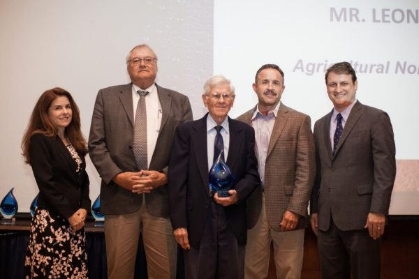 Leon New receives the 2017 Blue legacy Award for Agriculture (Non-Producer) from the Water Conservation Advisory Council (WCAC). Pictured Left to Right: Karen Guz, WCAC; Danny Krienke, NPGCD Board VP; Leon New; Harald Grall, NPGCD Board President; and Bech Bruun, Chairman of the Texas Water Development Board.