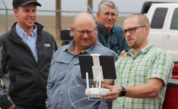 Master Irrigator presenter farmer, Bryce Howard, demonstrates the drone he uses in a variety of ways in his own operation. Class of 2017 graduates (left to right) Travis Spence, Darren Stallwitz, and Rex McCloy observe.
